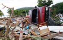 Man picks through debris of 2009 Samoa Tsunami
